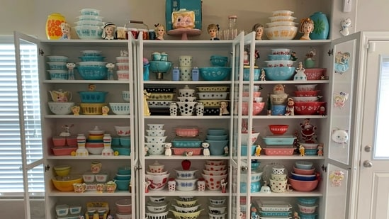 """This image provided by Megan Telfer shows the wide selection of antique Pyrex dishes she displays at her Texas home. Telfer has more than 300 pieces of vintage Pyrex, displayed on three large bookcases. Telfer's 5-year-old daughter has some vintage Pyrex, too. """"We don't use 90 percent of it,"""" Telfer said. """"I display it."""" (AP)"""