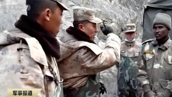 In this image taken from video footage run Feb. 19, 2021 by China's CCTV via AP Video, China's People's Liberation Army (PLA) regimental commander Qi Fabao, second from left, talks with members of the Indian military as Indian and Chinese troops face off in the Galwan Valley on the disputed border between China and India, June 15, 2020. China's military said Friday, Feb. 19, 2021 that four of its soldiers were killed in a high-mountain border clash with Indian forces last year, the first time Beijing has publicly conceded its side suffered casualties in the deadliest incident between the Asian giants in nearly 45 years. (CCTV via AP Video)(AP)