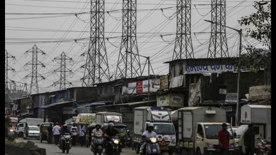 Electrical power lines hang from a transmission pylons alongside a road in Mumbai, on October 12, 2020. India's financial capital saw its biggest poweroutagein decades on the day. (File photo)