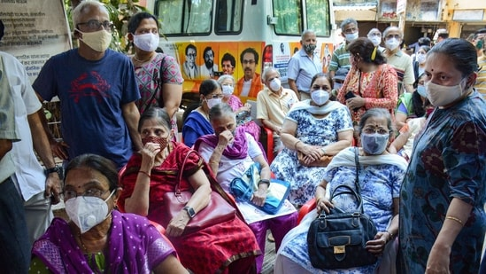 Elderly people wait for their turn to get vaccinated with Covid-19 vaccine, at a vaccination centre in Thane,(PTI)