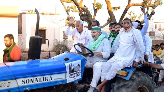 Bharatiya Kisan Union leader Rakesh Tikait (man at the wheel). (PTI Photo)