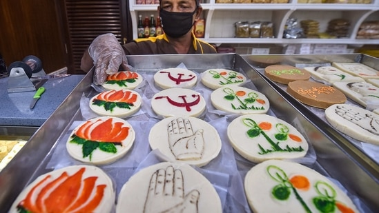 Kolkata: A vendor displays sweets with different political party symbols at his sweet shop, ahead of the State Assembly elections, in Kolkata, Wednesday, March 3, 2021. (PTI Photo/Swapan Mahapatra)(PTI03_03_2021_000049B)(PTI)