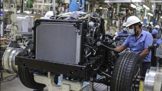 Workers at a chassis assembly line at the Toyota Kirloskar Motor Ltd. plant in Bidadi, Karnataka, India. (Bloomberg/Representational image)