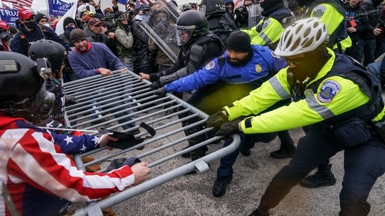 Rioters try to break through a police barrier at the Capitol in Washington on January 6.(AP / File Photo)
