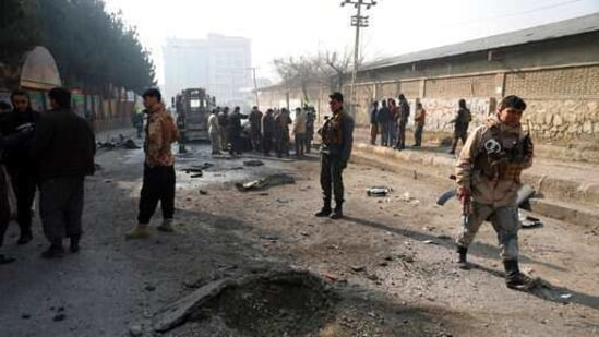 FILE - in this Jan. 10, 2021, file photo, Afghan security officers inspect the site of a bombing attack in Kabul, Afghanistan. After more than a month of delays, escalating violence and a flurry of diplomatic activity peace talks between the Taliban and the Afghan government have resumed Monday, Feb. 22, 2021, in the Middle Eastern State of Qatar. (AP Photo/Rahmat Gul, File)(AP)