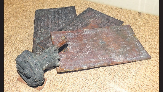 """A typical copperplate inscription with names, dates, allocations and the early links to how the name """"Pune"""" evolved. (Saili Palande-Datar/HT Photo)"""