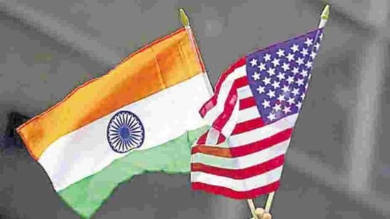 A man holds the flags of India and the US. (REUTERS)