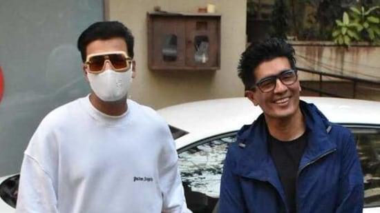 Karan Johar and Manish Malhotra arrived together at Kareena Kapoor's house and posed for the cameras.(Varinder Chawla)