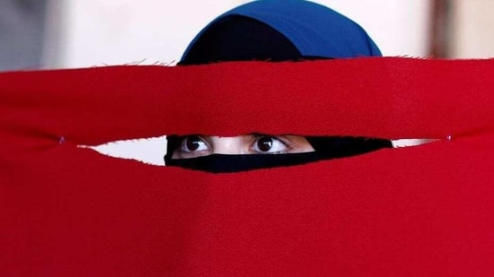 Alaa, 21, a student of health and nutrition, born in Copenhagen and wearer of the niqab, tests a face veil she created with members of the group Kvinder I Dialog (Women In Dialogue) during a workshop in preparation for a protest against the face veil ban in Copenhagen, Denmark. (Andrew Kelly / REUTERS)