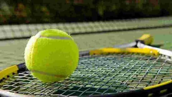 A tennis racket and new tennis ball on a freshly painted tennis court(HT Archive)