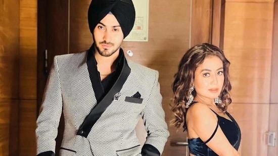 Neha Kakkar and Rohanpreet Singh pose together.