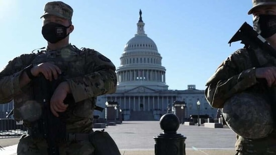 Members of the US National Guard stand watch in front of the Capitol building amid heightened security.(REUTERS)