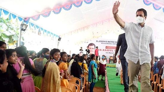 Congress leader Rahul Gandhi waves to students at St. Joseph's Matric Hr. Sec. School at Mulagumoodu in Kanyakumari.(ANI)