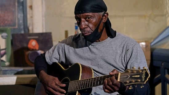 "Bluesman Jimmy ""Duck"" Holmes plays a quick ditty at the Blue Front Cafe in Bentonia, Miss., Jan. 21, 2021. Holmes' ninth album, ""Cypress Grove,"" has earned a Grammy nomination for the Best Traditional Blues Album.(AP)"