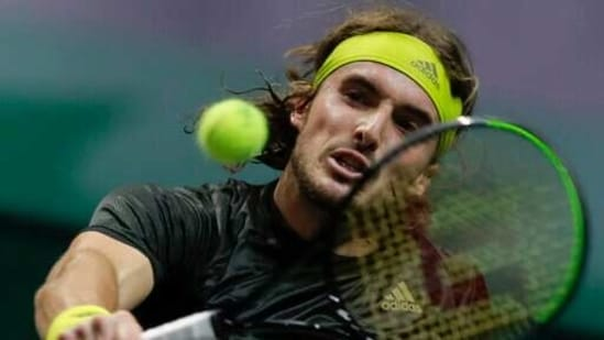Greece's Stefanos Tsitsipas plays a shot against Poland's Hubert Hurkacz in the second round men's singles match of the ABN AMRO world tennis tournament at Ahoy Arena in Rotterdam, Netherlands, Thursday, March 4, 2021. (AP)