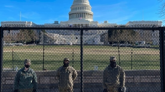 US National Guard soldiers guard the grounds of the US Capitol from behind a security fence in Washington, DC, on January 9, 2021. - US Democrats on January 9 were readying for an unprecedented second impeachment of Donald Trump as the defiant US President showed no signs of stepping down after the deadly violence at the Capitol on January 6. (Photo by Daniel SLIM / AFP)(AFP)