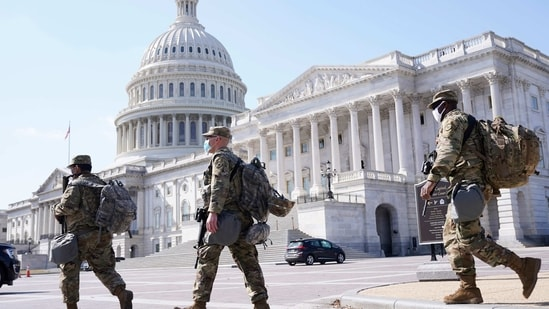 National Guard walk near the Capitol on March 4, 2021, on Capitol Hill in Washington. (AP)