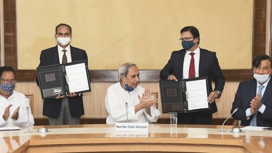 Bhubaneswar: Odisha Chief Minister Naveen Patnaik along with ArcelorMittal Chairman Lakshmi Niwas Mittal (R) during the signing of an MoU between the state government and ArcelorMittal Nippon Steel India Ltd for setting up an integrated steel plant and riverine port in Kendrapara District, in Bhubaneswar, Thursday, March 04, 2021. (PTI Photo)(PTI03_04_2021_000169B)(PTI)