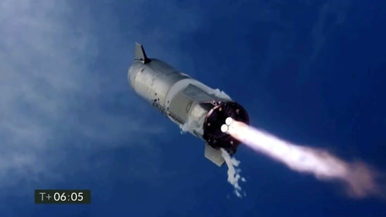 The company's Starship prototypes fires its thrusters as it lands during a test in Boca Chica, Texas, on Wednesday, March 3, 2021. The two previous attempts ended in explosions. (SpaceX via AP)
