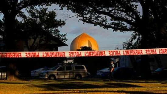 Police officer stands guard in front of the Masjid Al Noor mosque in Christchurch, New Zealand, where one of two mass shootings occurred.(AP / File Photo)