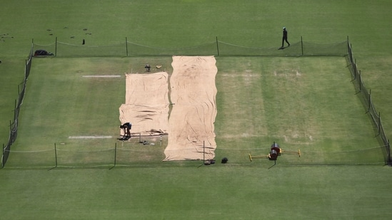 Pitch area is seen covered ahead of the fourth test cricket match between India and England at Narendra Modi Stadium in Ahmedabad.(AP)
