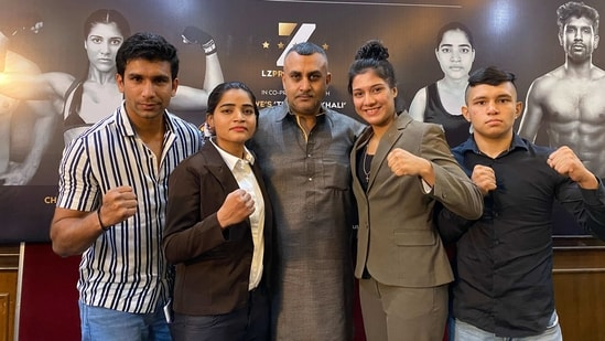 (L-R) Boxers Pawan Goyat, Suman, Chandn ... ence at Press club, Delhi on Friday