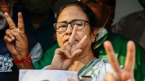 Chief Minister of West Bengal state and Trinamool Congress party leader Mamata Banerjee displays the victory symbol during the declaration of the names of the party's candidates for the upcoming legislative assembly elections in Kolkata, India, Friday, March 5, 2021. The eight phased legislative assembly elections in the state are scheduled to begin on March 27. (AP Photo/Bikas Das)(AP)