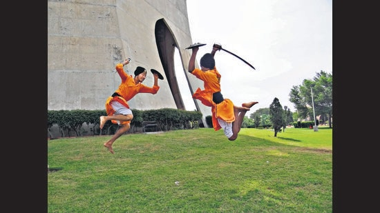 Gatka, a martial art of Sikh warriors that uses wooden sticks and leather shields, is played between two or more participants. (Photo courtesy National Gatka Association of India)