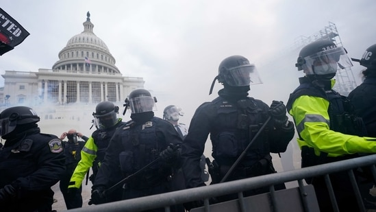 Police stand guard after holding off rioters who tried to break through a police barrier at the Capitol in Washington on January 6, 2021. (AP Photo )