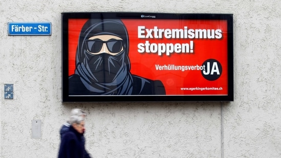 """A poster of the initiative committee against wearing the burqa reading """"Stop extremism! Veil ban - Yes"""" is seen in Zurich Switzerland.(REUTERS)"""