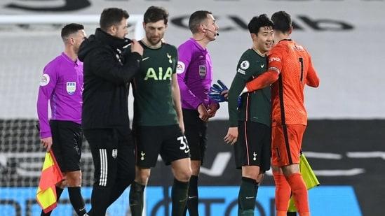 Tottenham Hotspur's Son Heung-min celebrates with Hugo Lloris after the match.(Pool via REUTERS)