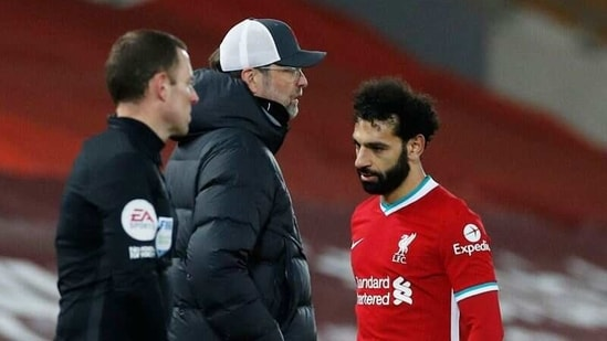 Liverpool's Mohamed Salah walks past manager Juergen Klopp after being substituted off.(Pool via REUTERS)