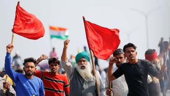 "Farmers shout slogans as they take part in a three-hour ""chakka jam"" on a highway.(REUTERS file photo)"