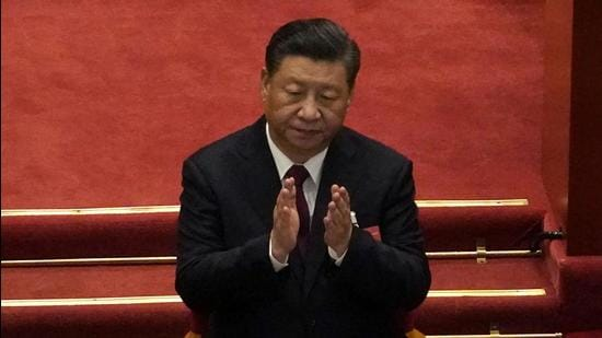 Chinese President Xi Jinping applauds during the opening session of China's National People's Congress (NPC) at the Great Hall of the People in Beijing on March 5, 2021. (AP)