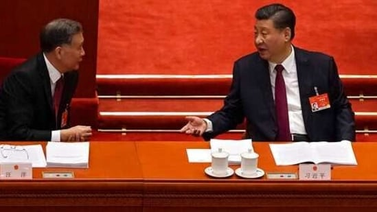 While officials seated in the rows behind them were all masked, Xi and Chinese Premier Li Keqiang moved around the Great Hall of the People, where the National People's Congress is opened every year, mask-free. (AP Photo/Andy Wong)(AP)