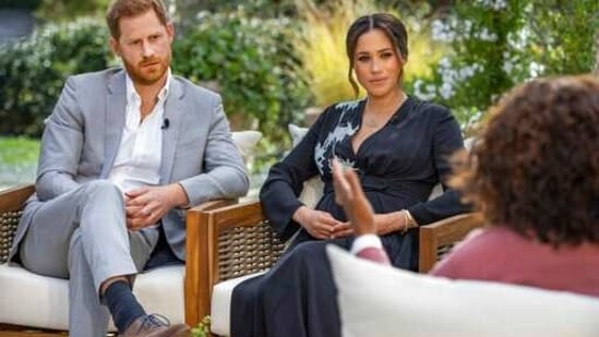 """This image provided by Harpo Productions shows Prince Harry, from left, and Meghan, The Duchess of Sussex, in conversation with Oprah Winfrey. """"Oprah with Meghan and Harry: A CBS Primetime Special"""" airs March 7. (Joe Pugliese/Harpo Productions via AP)(AP)"""
