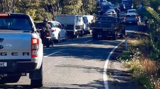 Traffic slowly works up to high ground in Whangarei, New Zealand, as a tsunami warning is issued Friday, March 5, 2021. A powerful magnitude 8.1 earthquake struck in the ocean off the coast of New Zealand prompting thousands of people to evacuate and triggering tsunami warnings across the South Pacific.(AP)