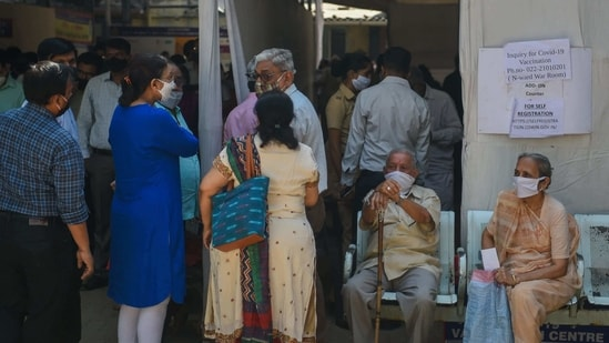 Senior citizens wait to register at a counter for a Covid-19 coronavirus vaccine at the Rajawadi hospital in Mumbai on March 3, 2021. (AFP)
