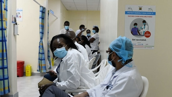 Kenyan health workers waiting to receive a dose of the Oxford/AstraZeneca vaccine, part of the COVAX mechanism by GAVI (The Vaccine Alliance), to fight against COVID-19 at the Kenyatta National Hospital in Nairobi on March 5, 2021. (AFP)