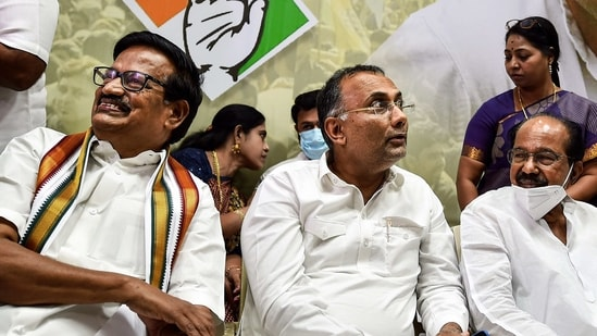 """""""We will fight for a respectable number of seats to keep the morale of the Congress men very high,"""" Moily said. In picture - Congress leaders K.S. Alagiri (left), M. Veerappa Moily (right) and Dinesh Gundu Rao (centre).(PTI)"""