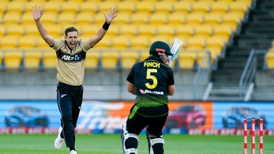 New Zealand's Tim Southee, left, appeals for the wicket of Australia's Aaron Finch, right, during the third T20 cricket international between Australia and New Zealand at Wellington Regional Stadium in Wellington, New Zealand, Wednesday, March 3 , 2021. (John Cowpland/Photosport via AP)(AP)