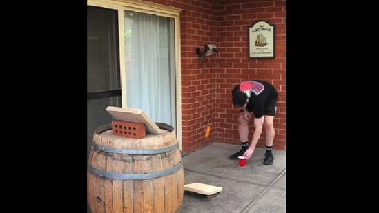 The image shows Cam James attempting the trick shot.(Reddit/oddlysatisfying)