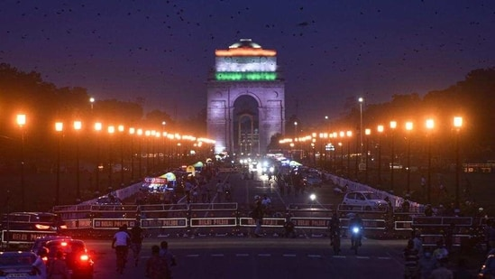Illuminated view of India Gate on the eve of Independence Day at Vijay Chowk in New Delhi, India, on Friday, August 14, 2020. (Sanchit Khanna/HT PHOTO)