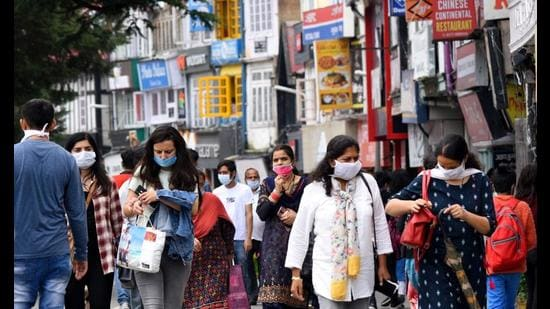 Tourists at the Mall in Shimla. One of the hardest hit sectors by the Covid-19 pandemic has been tourism. It saw a contraction of 81.33% in foreign and domestic tourist arrivals in 2020. (HT file photo)