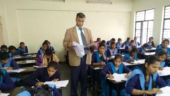 Chairman, Bihar School Examination Board, Anand Kishore is inspecting examinee students at examination centre in Patna(HT File)