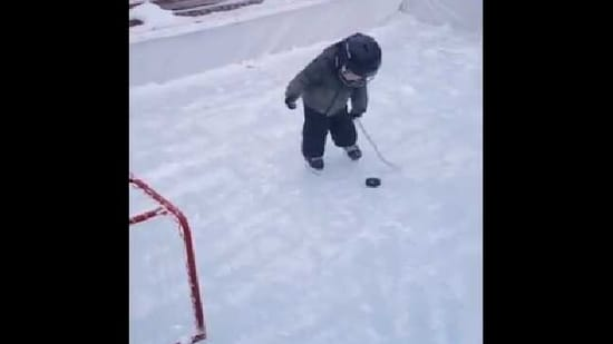 The image shows the kid playing ice hockey.(Twitter/@rexchapman)
