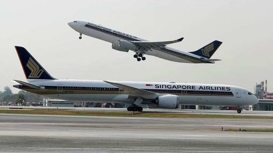 A Singapore Airlines Airbus A330-300 plane takes off behind a Boeing 787-10 Dreamliner at Changi Airport in Singapore.(Reuters/ File photo)