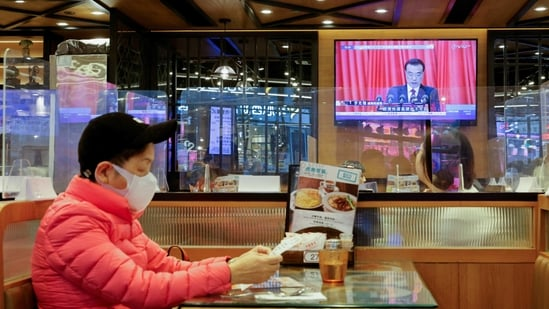 A TV screen showing news over the opening session of the National People's Congress (NPC), is seen in Hong Kong, China March 5, 2021. REUTERS/Tyrone Siu(REUTERS)