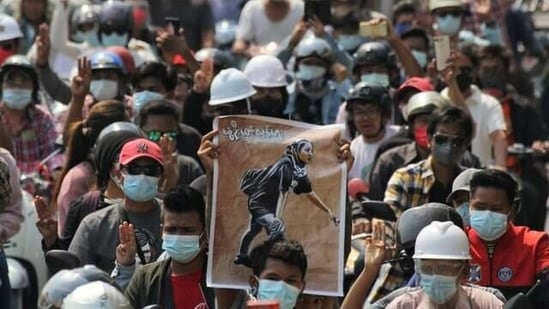 People attend the funeral of Angel a 19-year-old protester also known as Kyal Sin who was shot as Myanmar forces opened fire to disperse an anti-coup demonstration in Mandalay, Myanmar on March 4, 2021. (Reuters)