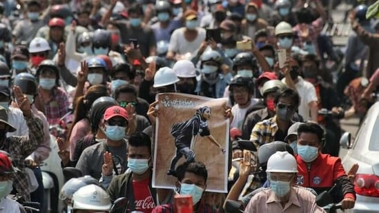 In picture - People attend the funeral of Angel a 19-year-old protester also known as Kyal Sin who was shot in the head as Myanmar forces opened fire to disperse an anti-coup demonstration in Mandalay on March 4.(Reuters)